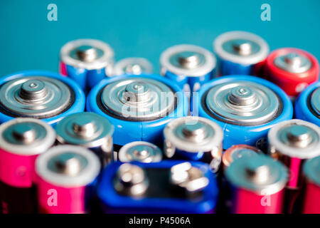 Ecology recycling concept. Many different types used or new battery, rechargeable accumulator, alkaline batteries on color background. Nature energy - Stock Photo