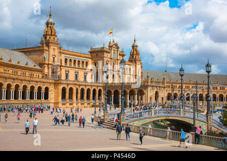 Plaza de Espana Seville, view of people walking through the historic Plaza de Espana in Seville (Sevilla) on a summer afternoon, Andalucia, Spain.