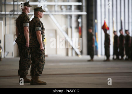 U.S. Marine Corps Lt. Col. Jason B. Berg, left, incoming commanding officer for Marine Wing Support Squadron (MWSS) 171, and Lt. Col. James S. Whiteker, outgoing commanding officer for MWSS-171, stand before a squadron formation during a change of command ceremony at Marine Corps Air Station Iwakuni, Japan, June 30, 2016. Whiteker relinquished his duties as MWSS-171 commanding officer toBerg after serving as the squadron commander for two years. Living by the motto, 'In Omnia Paratus,' meaning 'ready for all things,' Berg will take charge to ensure the legacy of operational readiness is mainta - Stock Photo