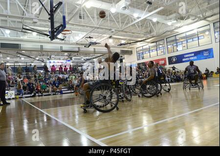 Army Spc, June 4, 2018. Vairon Caicedo Ocampo from Team SOCOM takes a shot against Navy in the wheelchair basketball game during the 2018 Warrior Games held at the Air Force Academy in Colorado Springs June 4, 2018. Several members of Team SOCOM advanced to the finals. Created in 2010, the DoD Warrior Games introduce wounded, ill and injured service members and veterans to Paralympic-style sports. Warrior Games showcases the resilient spirit of today's wounded, ill or injured service members from all branches of the military. These athletes have overcome significant physical and behavioral inj - Stock Photo