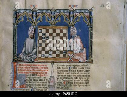 LIBRO DE JUEGOS O LIBRO DEL AJEDREZ DADOS Y TABLAS - 1283 - FOLIO 38R - DETALLE - DOS ARABES CON UN LIBRO JUGANDO AL AJEDREZ - Conj nº 90059. Author: Alfonso X of Castile the Wise (1221-1284). Location: MONASTERIO-BIBLIOTECA-COLECCION, SAN LORENZO DEL ESCORIAL, MADRID, SPAIN. - Stock Photo