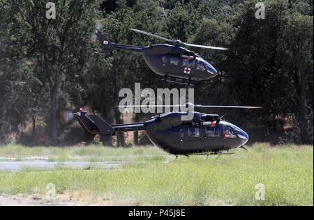 UH-72A Lakota helicopters from the 3/ 140 Aviation Security and Support Battalion, California Army National Guard, take off from Ward Tactical Assembly Area at Fort Hunter Liggett, California, June 15, 2016. Aboard were  Tusi Airfield to provide an aerial view of the training. CSTX 91-16-02 is a multi-component, joint, and international exercise with more 50 units participating from the U.S. Army, U.S. Air Force, U.S. Navy, and Canadian Army.  (U.S. Army Photo by Sgt. 1st Class Clinton Wood/Released). - Stock Photo