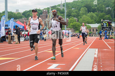 U.S Army Veterans Sgt. 1st Class, Allan Armstrong, of Killeen, Texas, and Capt. William Reynolds, of Pittsford, New York, participate in the 1500-meter track event during the 2016 Department of Defense Warrior Games in Shea Stadium, at the United States Military Academy, at West Point, New York, June 16. (U.S. Army photo by Spc. Sarah Pond/Released) - Stock Photo