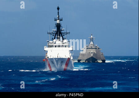 160624-N-MZ309-365 PACIFIC OCEAN (June 24, 2016) Legend-class cutter USCGC Stratton (WMSL 752) and littoral combat ship USS Coronado (LCS 4) steam in formation while transiting to Rim of the Pacific 2016. Twenty-six nations, more than 40 ships and submarines, more than 200 aircraft and 25,000 personnel are participating in RIMPAC from June 30 to Aug. 10, in and around the Hawaiian Islands and Southern California. The world's largest international maritime exercise, RIMPAC provides a unique opportunity that helps participants foster and sustain the cooperative relationships that are critical to - Stock Photo