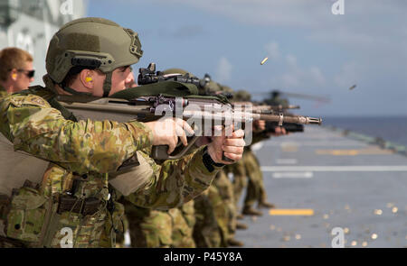 Australian Army soldier Private Braden Howard from 2nd Battalion, Royal Australian Regiment, takes part in a live-fire training drill on the flight deck of HMAS Canberra en route to Exercise RIMPAC on 20 June 2016. (Australian Defence Force photo by LSIS Helen Frank) - Stock Photo