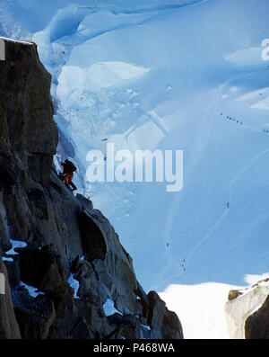 Climbers on the Cosmiques Arête of the Aiguille du Midi in the French Alps, Chamonix - Stock Photo