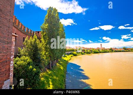 Adige river and Verona riverfront view from Castelvecchio Bridge, famous landmark in tourist destination in Veneto region of Italy - Stock Photo
