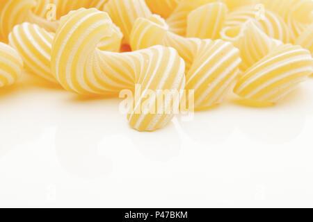 Group of macaroni pasta on white background - Stock Photo