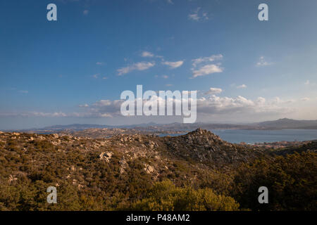 View from the Italian island of La Maddalena to Palau on the Italian island of Sardinia with boats and ferries sailing back and forth between the isla - Stock Photo
