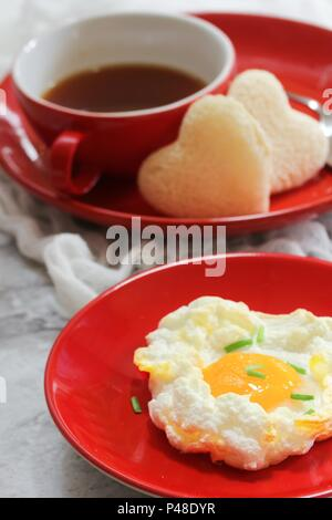 Breakfast baked Cloud Egg on red plate - Stock Photo