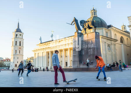 Vilnius, Lithuania : Young skaters by the  equestrian statue of Gediminas at Cathedral Square. - Stock Photo