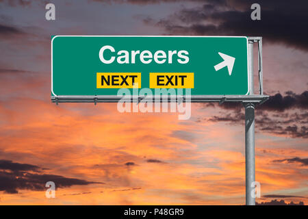 Careers next exit freeway sign with sunset sky. - Stock Photo