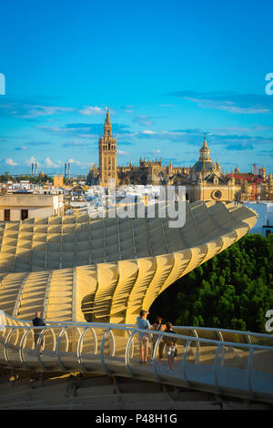 Seville Metropol Parasol, view at sunset from the Las Setas (the Metropol Parasol) walkway towards the old city skyline of Seville, Andalucia, Spain. - Stock Photo