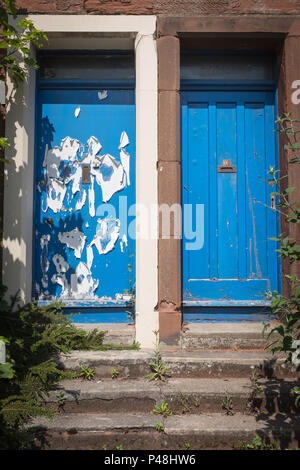 View of two doors in run down properties which have been put on the market for sale. - Stock Photo