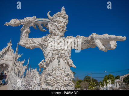 Chiang Rai, Thailand - in Thailand 95% of the population adheres to Buddhism. Here in particular the Wat Rong Khun temple - Stock Photo