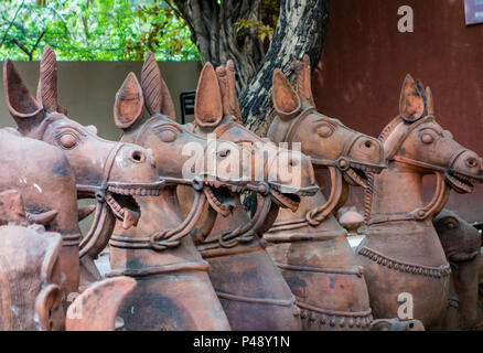 Exhibit of stone carvings of horses typical of Rajasthan in the National Crafts Museum, New Delhi, India - Stock Photo