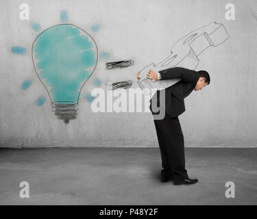 Idea is money drawing with man carrying concrete wall - Stock Photo