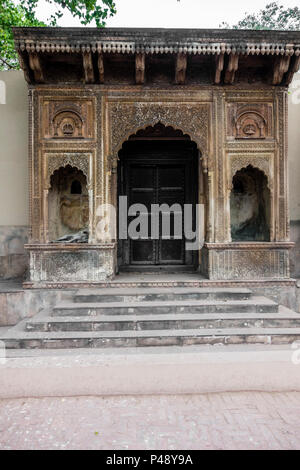 Exhibit of a gateway to a haveli or mansion typical of Rajasthan in the National Crafts Museum, New Delhi, India - Stock Photo