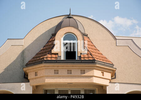 Vintage dormer and window on roof at house. Retro style toned facade and architecture concept. Close up - Stock Photo