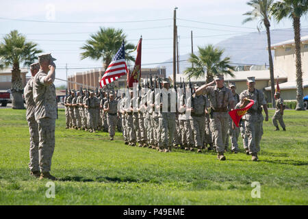 Lt. Col. Christopher Siler, on-coming commanding officer, and Lt. Col. Steven Murphy, outgoing commanding officer, Marine Wing Support Squadron 374, conduct a pass-in-review during the unit's change of command at Lance Cpl. Torrey L. Gray Field, June 17, 2016. (Official Marine Corps photo by Cpl. Thomas Mudd/Released) - Stock Photo