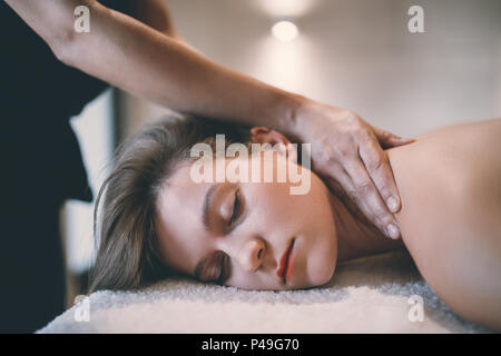 Rejuvenating relaxing massage by masseur - Stock Photo