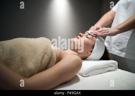 Relaxing anti stress facial massage - Stock Photo