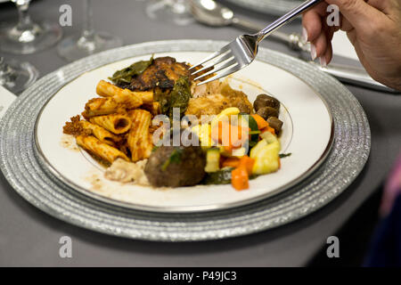 Pasta rigatony with meat sauce, sauteed vegetables, chicken marsala, grilled salmon and beef tenderloin medallions - Stock Photo