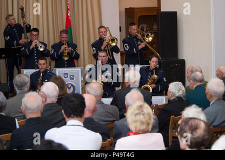 The U.S. Air Forces in Europe's Band Ambassadors Jazz Ensemble performs at the Friendship House June 20, 2016, in Minsk, Belarus. The band played a concert for WWII veterans, Afghanistan conflict veterans and Chernobyl liquidators. Scott Rauland, U.S. Chargé d'Affaires to Belarus, and Svetlana Alexievich, a Nobel Prize laureate, were also in attendance. The United States, Belarus, and other ally and partner nations continue to remember and honor shared World War II sacrifices. The USAFE Band's performances reflect shared memories and seek to encourage future partnerships. - Stock Photo