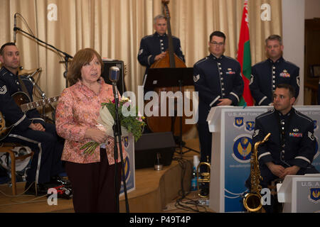 Svetlana Alexievich, a Nobel Prize laureate, greets the audience after a concert by the U.S. Air Forces in Europe's Band Ambassadors Jazz Ensemble at the Friendship House June 20, 2016, in Minsk, Belarus.The band played a concert for WWII veterans, Afghanistan conflict veterans and Chernobyl liquidators. - Stock Photo