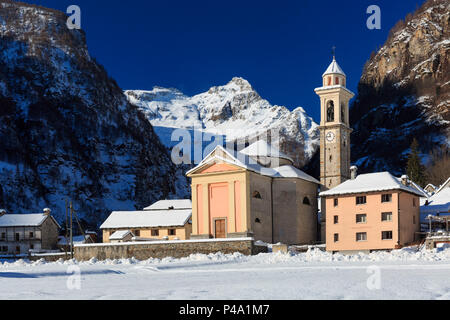 The church of the village Sonogno in winter with Mount Zucchero in the background, Sonogno, Val Verzasca, Canton Ticino, Switzerland, Europe - Stock Photo