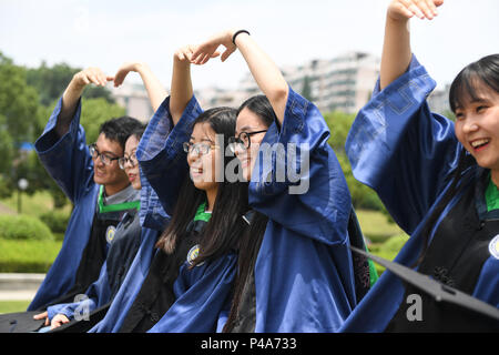 Nanjing, China's Jiangsu Province. 21st June, 2018. Graduating master's students pose for photos at Nanjing Agricultural University in Nanjing, east China's Jiangsu Province, June 21, 2018. Credit: Ji Chunpeng/Xinhua/Alamy Live News - Stock Photo