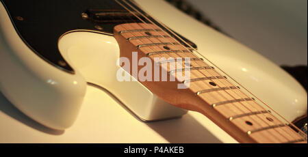closeup.black electric guitar on white background. photo with copy space - Stock Photo
