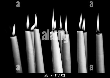 Candles lit, detail of old lighting element - Stock Photo