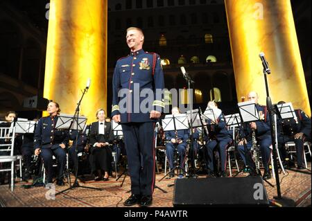 Coast Guard Lt. Cmdr. Adam R. Williamson, director of the Coast Guard Band, concludes the band's performance at the Coast Guard Foundation's 14th Annual Tribute to the United States Coast Guard In Our Nation's Capital, at the National Building Museum, Washington, D.C. June 5, 2018, June 5, 2018. Coast Guard photo by Petty Officer 2nd Class Lisa Ferdinando. () - Stock Photo