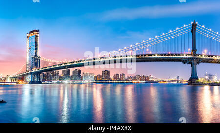 Manhattan Bridge panorama at dawn - Stock Photo