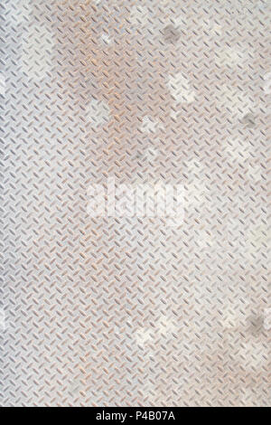 Closeup portrait, distressed, mottled, gungy industrial diamondplate, chequerplate rusty metal background texture with diamond grip pattern perfect fo - Stock Photo
