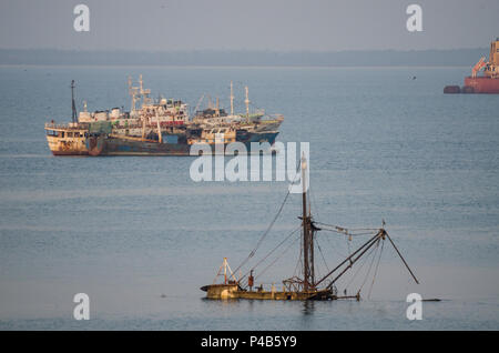 Freetown, Sierra Leone - January 09, 2014: Old and abandoned ships and ship wrecks rusting and sinking at coast of Sierra Leone. - Stock Photo