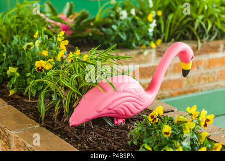 USA, New Jersey, The Jersey Shore, Wildwoods, 1950s-era Doo-Wop architecture, plastic pink flamingo - Stock Photo