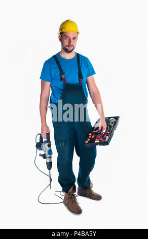Handyman standing isolated on white in studio - Stock Photo