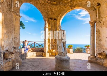 Villa Cimbrone, Ravello, Amalfi coast, Salerno, Campania, Italy. Girl sitting in the temple of Ceres Goddess - Stock Photo