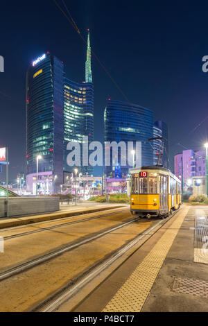 View of the Unicredit Tower spire from the tram stop of avenue Luigi Sturzo during the evening. Milan, Lombardy, Italy. - Stock Photo