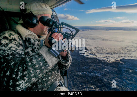 Filming a Volcano Eruption from a helicopter. August 29, 2014, a fissure eruption occurred in Holuhraun at the northern end of a magma intrusion which had moved progressively north, from the Bardarbunga volcano. Bardarbunga is a stratovolcano located under Vatnajokull, Iceland's most extensive glacier, picture Date-Sept. 28, 2014 - Stock Photo