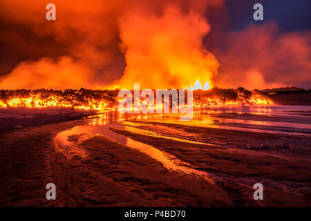 Glowing lava from the eruption at the Holuhraun Fissure, near the Bardarbunga Volcano, Iceland. August 29, 2014, a fissure eruption started in Holuhraun at the northern end of a magma intrusion, which had moved progressively north, from the Bardarbunga volcano. Picture date- Sept 2, 2014 - Stock Photo