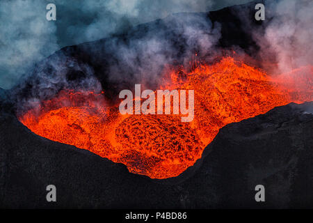 Aerial view of lava flow. August 29, 2014 a fissure eruption started in Holuhraun at the northern end of a magma intrusion, which had moved progressively north, from the Bardarbunga volcano. Bardarbunga is a stratovolcano located under Vatnajokull, Iceland's most extensive glacier. Picture Date: October 30, 2014 - Stock Photo