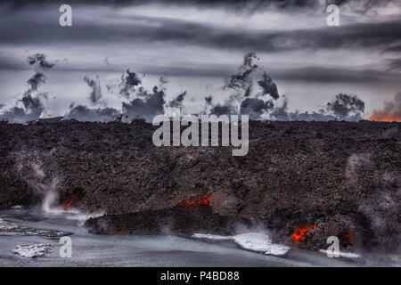Aerial view of lava and steam. August 29, 2014 a fissure eruption started in Holuhraun at the northern end of a magma intrusion, which had moved progressively north, from the Bardarbunga volcano. Bardarbunga is a stratovolcano located under Vatnajokull, Iceland's most extensive glacier. Picture Date: October 30, 2014 - Stock Photo