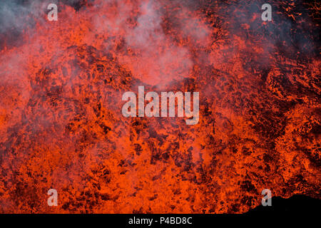 Aerial view of lava and plumes. August 29, 2014 a fissure eruption started in Holuhraun at the northern end of a magma intrusion, which had moved progressively north, from the Bardarbunga volcano. Bardarbunga is a stratovolcano located under Vatnajokull, Iceland's most extensive glacier. Picture Date-Sept. 28, 2014 - Stock Photo
