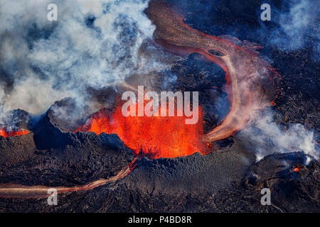 Volcano eruption at the Holuhraun Fissure near Bardarbunga Volcano, Iceland Aerial view of the lava fountains and massive plumes, Holuhraun Fissure, near the Bardarbunga Volcano, Iceland. August 29, 2014, a fissure eruption started in Holuhraun at the northern end of a magma intrusion that had moved progressively north, from the Bardarbunga volcano. Picture date Sept 1, 2014. Bardarbunga is a subglacial stratovolcano located under the Vatnajokull. - Stock Photo