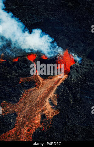 Volcano Eruption at the Holuhraun Fissure near Bardarbunga Volcano, Iceland. Aerial view of lava and plumes. August 29, 2014 a fissure eruption started in Holuhraun at the northern end of a magma intrusion, which had moved progressively north, from the Bardarbunga volcano. Picture Date-Sept. 3, 2014 - Stock Photo