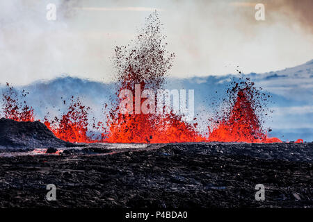 Aerial view of lava and plumes. August 29, 2014 a fissure eruption started in Holuhraun at the northern end of a magma intrusion, which had moved progressively north, from the Bardarbunga volcano. Bardarbunga is a stratovolcano located under Vatnajokull, Iceland's most extensive glacier. Picture Date: September 3, 2014 People standing by Flosagja fissure, Thingvellir National Park, Iceland - Stock Photo