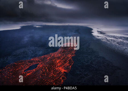 Aerial view of lava and plumes. August 29, 2014 a fissure eruption started in Holuhraun at the northern end of a magma intrusion, which had moved progressively north, from the Bardarbunga volcano. Bardarbunga is a stratovolcano located under Vatnajokull, Iceland's most extensive glacier. Picture Date-October 30, 2014 - Stock Photo
